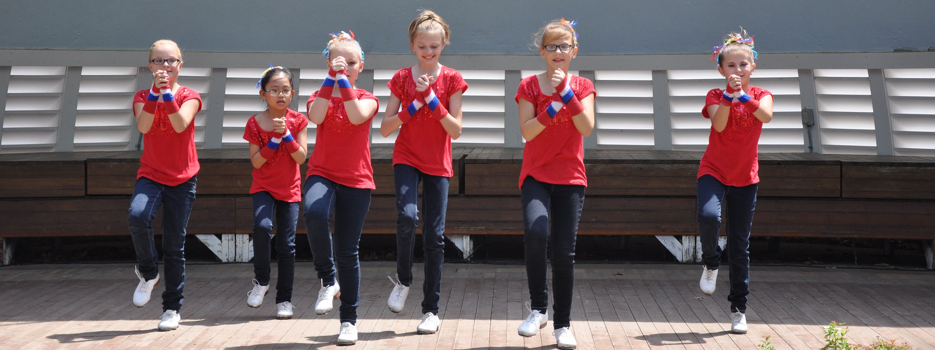 Children dancing on the Bandshell stage on July 4th in Seward, Nebraska